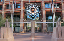 Modern office building entrance. A downtown, modern office building entrance with an abstract sculpture of the sun. Taken in downtown Phoenix, Arizona 2016 Stock Photo