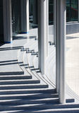 Modern office building entrance, steps and pillars. View of modern office building entrance, steps and pillars royalty free stock photography
