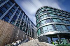 Modern office building in the evening,Glass and metal building Royalty Free Stock Images