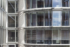 Modern office building exterior -  glass facade Stock Images