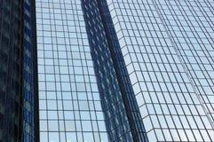 Modern office building facade. A modern and futuristic office building facade stock photography