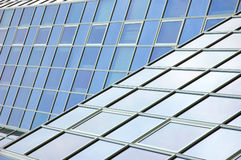 Modern office building facade. A modern and futuristic office building facade with reflections in it stock image