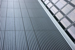 Modern office building facade. A modern and futuristic office building facade royalty free stock photography