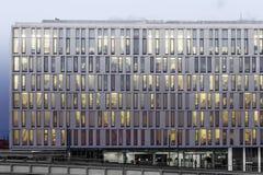 Modern office building facade at night Stock Photo