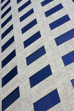 Modern office building facade whit blue windows. Royalty Free Stock Photo