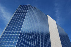 Modern office building with glass & cement facade Royalty Free Stock Photo