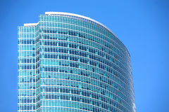 Modern office building glass wall top section closeup Royalty Free Stock Image