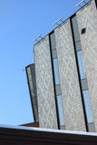 Office building with gray walls on blue sky Stock Photography