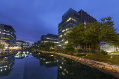 Modern office building. In Hong Kong city at dusk stock images