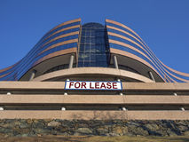 Modern office building for lease or rent. Modern office building in glass and pink granite available for lease or rent Royalty Free Stock Image