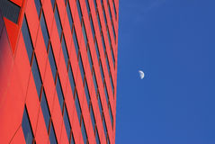 Modern office building and the moon Stock Images