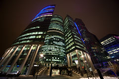 Modern office building at night Stock Photos