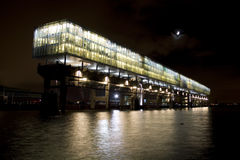 Modern office building by night. Kraanspoor building, Amsterdam royalty free stock photo