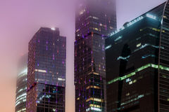 Modern office building night fog Royalty Free Stock Photo