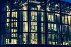 Modern office building at night, Hamburg, Germany royalty free stock photos