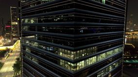 Modern office building at night. Night lights, city office building downtown, cityscape view. Shot. Corporation office. Buildings at night. Late working stock footage