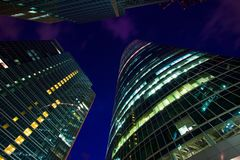 Modern office building at night, skyscraper Stock Photos