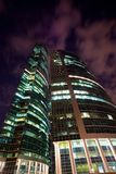 Modern office building at night, skyscraper Stock Images