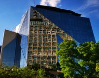 Modern office building and the old TVR headquarter in the mirror. Reflection in windows stock image