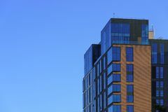 Modern office building over blue sky. Royalty Free Stock Photography