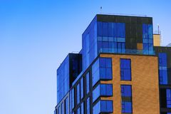 Modern office building over blue sky. Royalty Free Stock Photos