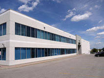 Modern Office building and parking lot Royalty Free Stock Image