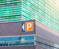 Modern office building with parking pointer afternoon. Modern office building with parking pointer Royalty Free Stock Image
