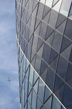 Modern office building with plane royalty free stock photos