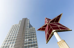 Modern office building and a ruby star Stock Photography