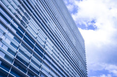 Modern office building. On a sunny day with blue sky above it royalty free stock photos