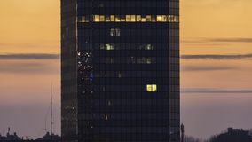 Modern office building during sunset stock video footage