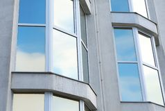 Modern office building with tinted windows. Urban architecture stock image