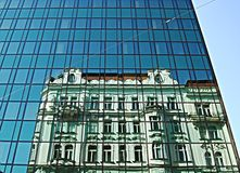 Modern office building wall. Modern office building glass wall, reflection stock photos