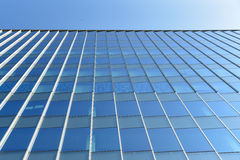 Modern office building wall made of blue glass and steel frame Stock Images