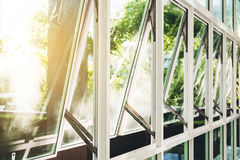 Modern office building wall and opened window in the morning, with bright sunlight. Modern office building wall and open window in the morning, with bright Royalty Free Stock Photography