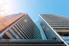 Free Modern Office Building With Facade Of Glass On Sky Background Royalty Free Stock Photos - 150568328