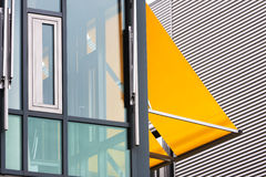 Modern office building with yellow awnings. Closeup of a modern office building with yellow awnings Stock Photography