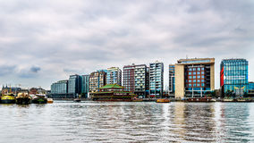 Modern Office Buildings along the shores of the Harbor in Amsterdam. View of Modern Office Buildings along the shores of the Harbor named Het IJ in Amsterdam Stock Photos