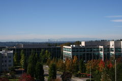 Modern Office Buildings in Autumn. Modern office buildings at Bellevue Washington in Autumn with Seattle city skyline in background with Olympic mountains stock photography