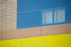Modern office buildings. Colorful buildings in a industrial place. Blue and yellow windows. Royalty Free Stock Image