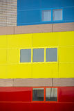 Modern office buildings. Colorful buildings in a industrial place. Yellow, blue and red windows. Stock Photo