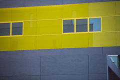 Modern office buildings. Colorful buildings in a industrial place. Yellow windows. Stock Image