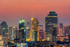 Modern office buildings, condominium in big city downtown. At twilight time Bangkok,Thailand stock photo