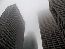 Modern office buildings in the fog Stock Photography
