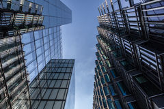 Modern office buildings in London on sunny day with blue sky. Modern office buildings in the city royalty free stock photo