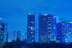 Modern office buildings at night Stock Photography