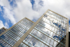 Modern office buildings over cloudy sky. With reflection in windows Royalty Free Stock Images