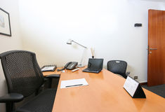 Modern office. Modern business office with tables, chairs, computer, phone and all accessories for the job Stock Image