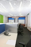Modern office. Modern business office with tables, chairs, computer, phone and all accessories for the job Royalty Free Stock Photography