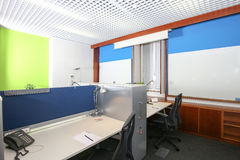 Modern office. Modern business office with tables, chairs, computer, phone and all accessories for the job Stock Photo